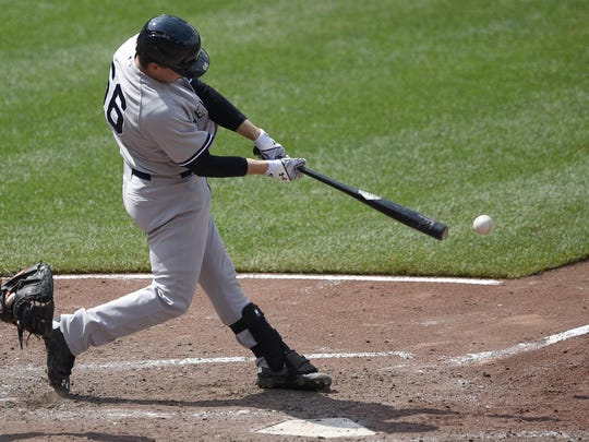 New York Yankees' John Ryan Murphy hits a double to drive in two runs against the Baltimore Orioles during the fifth inning of a baseball game, Sunday, June 14, 2015, in Baltimore. The Yankees won 5-3. (AP Photo/Nick Wass)
