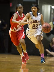 Montgomery Academy's Kayla White (22) drives on Greensboro's