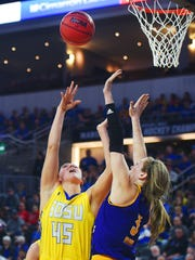 SDSU's Ellie Thompson attempts to score a point during