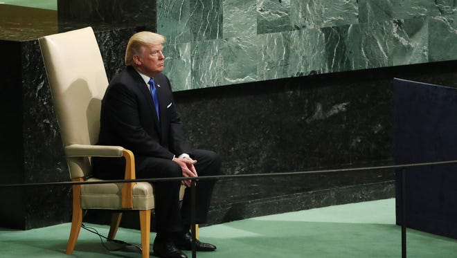 President Trump sits in the head of state chair after speaking during the opening session of the General Debate of the 72nd United Nations General Assembly at UN headquarters in New York.