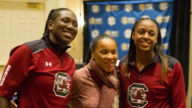 USC's Aleighsha Welch, coach Dawn Staley and Tiffany Mitchell pose for a picture during the SEC media day on Oct. 21, 2014.