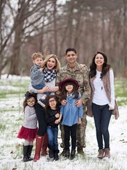 Cassaundra Martinez and her family. She and her husband