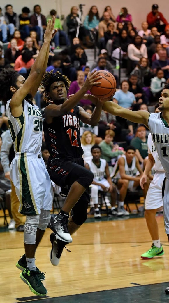 Senior guard Tuzion Brock (12) and the Southside Tigers