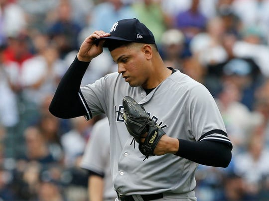 Sep 13, 2017; New York City, NY, USA; New York Yankees relief pitcher Dellin Betances (68) pauses before pitching against the Tampa Bay Rays in the eighth inning at Citi Field.