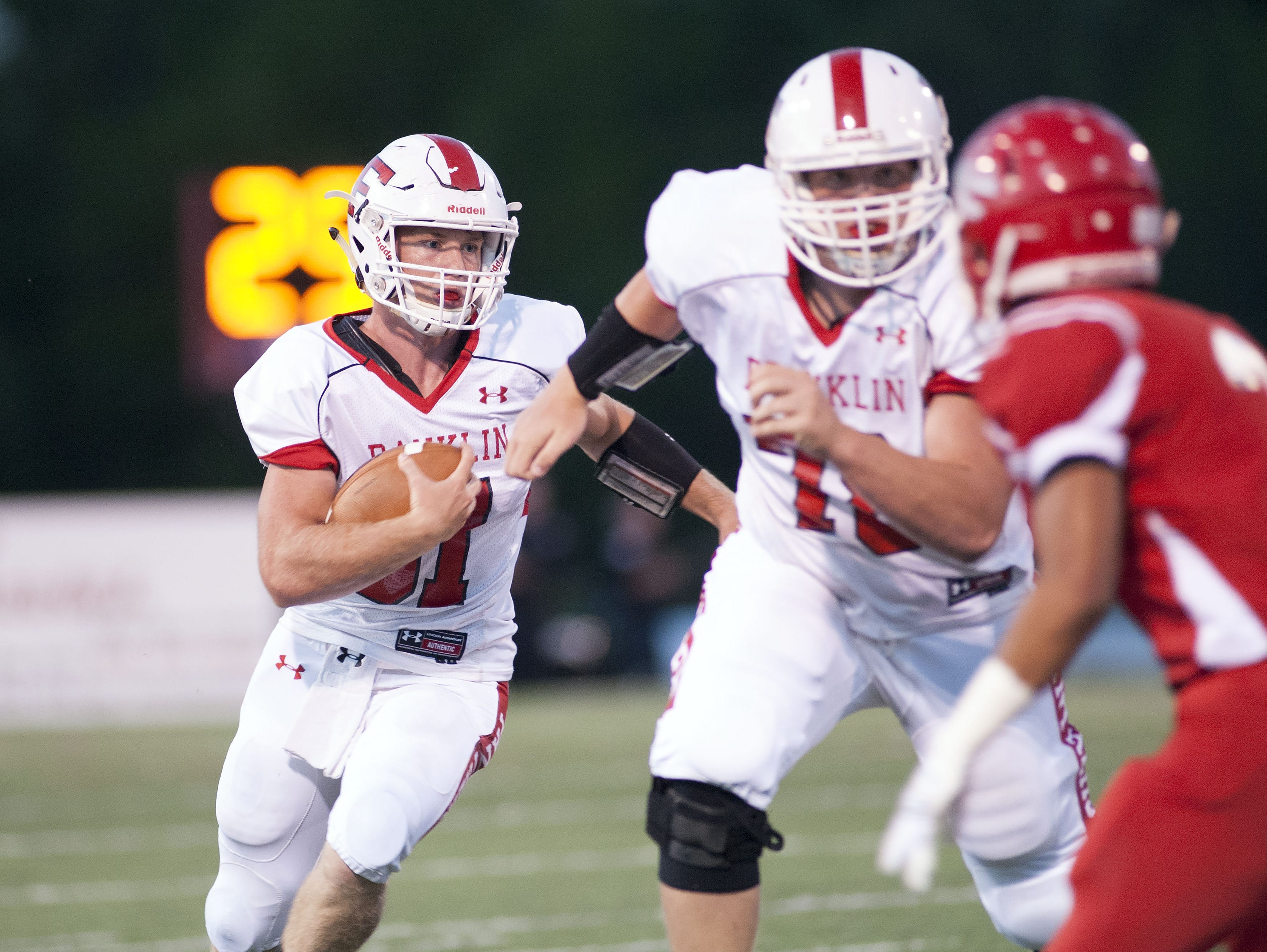 Kelton Lowry, left, rushed for more than 2,000 yards behind an offensive line led by Wyatt Burnette.