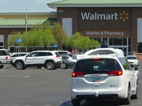 A Waymo car in a Walmart parking lot