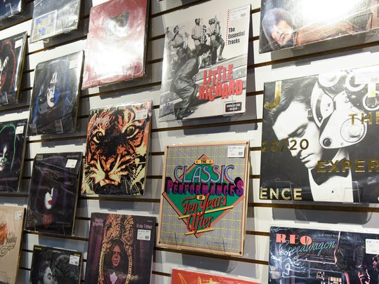 Classic albums line the walls of Fan HQ Rock N Jock inside Crossroads Center in St. Cloud.
