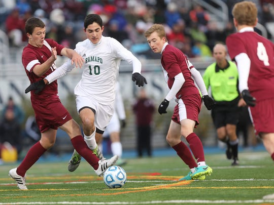 Ryan Laycock of Toms River South tries to stop Sebastian Varela of Ramapo Sunday.  Varela scored two goals as Ramapo beat Toms River South, 3-0 for the Boys NJSIAA State Group III Championship at Kearny University in Union Sunday, November 20, 2016.
