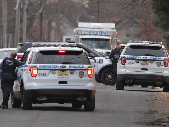 Police vehicles fill Johnson Avenue in Matawan Monday