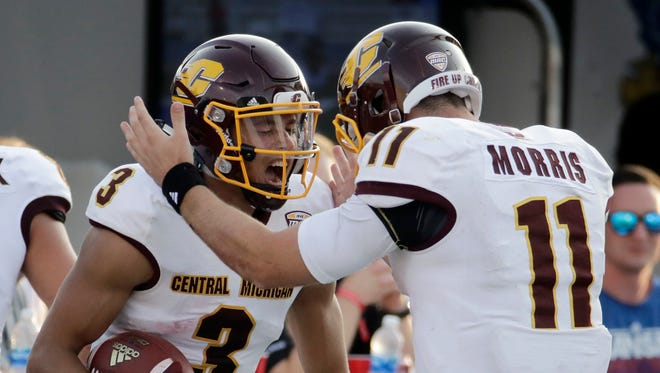 Central Michigan receiver Mark Chapman celebrates with quarterback Shane Morris after Chapman's 75-yard touchdown in the fourth quarter against Kansas, Sept. 9, 2017 in Lawrence, Kansas.
