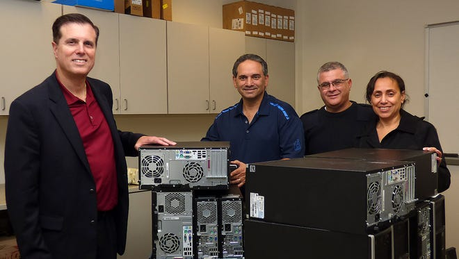 (From left) Paul Ritter, president and chief executive officer of the Cumberland Insurance Group, Victor LaTorre, Miguel Barrera, director of Salvation Army of Vineland, and America Barrera, co-director of Salvation Army of Vineland, are pictured with some of the items Cumberland Insurance Group donated to the Salvation Army.