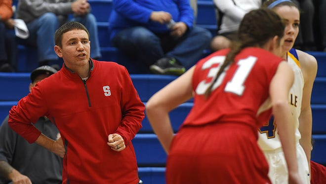 Sheridan head coach J. D. Walters watches his team take on Maysville last season. Walters is back for his third season.