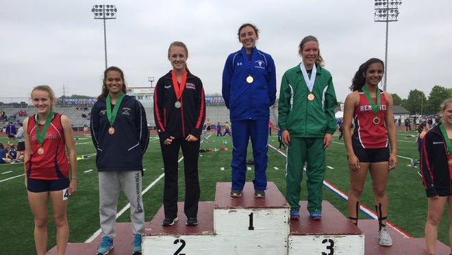 Cedar Crest's Shayla Bonzelet stands atop the medal stand with her gold medal after winning the L-L title in the 400 meters on Saturday.