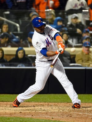 New York Mets pinch hitter Juan Uribe hits a RBI single against the Kansas City Royals in the 6th inning in Game 3 of the World Series at Citi Field.
