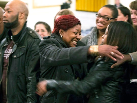 Maria Hamilton, center, hugs a supporter after a panel of three Fire and Police Commission members upheld the firing of police officer Christopher Manney during a hearing at Centennial Hall in Milwaukee on Monday.