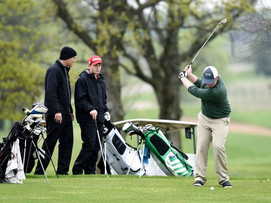 Golfers tee off at Territory Golf Club in St. Cloud Wednesday during the Apollo boys golf invitational.