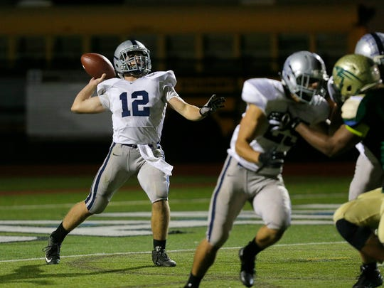 Manasquan's QB Tommy Antonucci passes the ball during the first half of the Manasquan at Red Bank Catholic football game in Red Bank, NJ Friday, November 4, 2016.