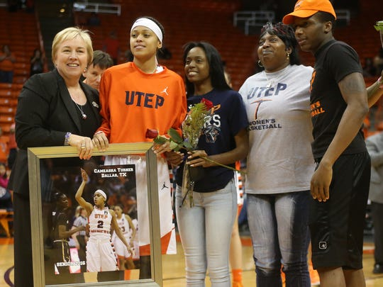 Cameasha Turner is honored during Senior Day by coach