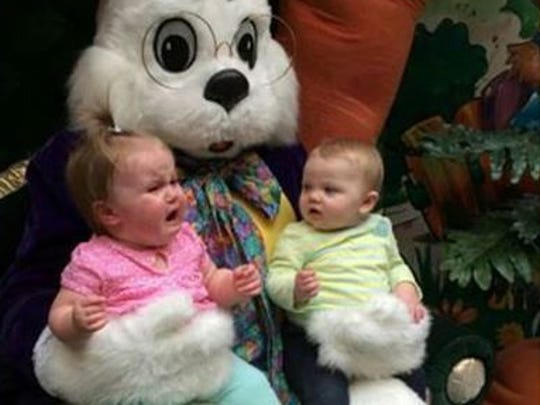 Emry (right), 8 months, is embarrassed that her older cousin Ashlyn, 1 year, can't handle the Easter bunny.