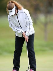 Shelby junior Alexis Jones putts on No. 2 during Saturday's