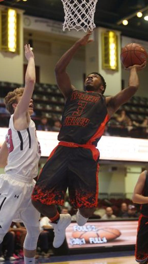 Spring Valley's Andre Williams drives to the basket