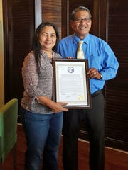 Sen. Joe S. San Agustin presented Elaine Fejarang with