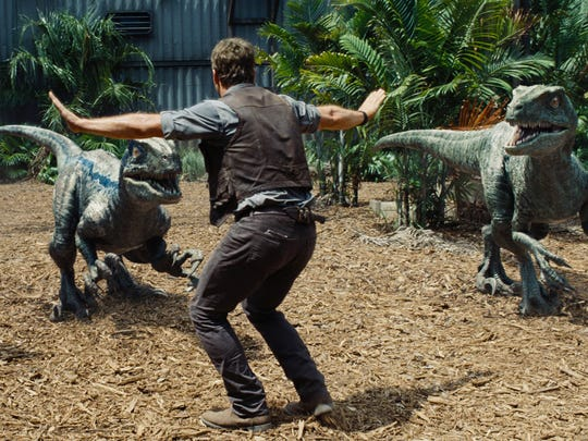 Owen (Chris Pratt) attempts to keep the raptors at bay in 'Jurassic World.'