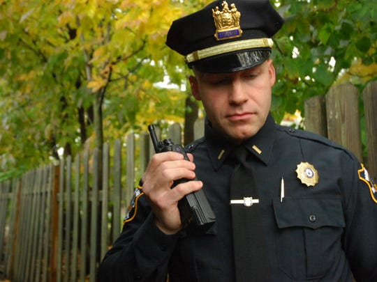 A police officer using a radio.