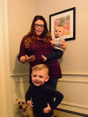 Carolyn Stack and her children, Duke 3 (front) and