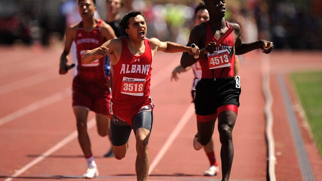 Albany's Roman Fuentes (3518) celebrates after crossing the finish line in second place in the Class 2A boys mile relay during the UIL State Track and Field Championships on Saturday, May 13, 2017, at Mike A. Myers Stadium in Austin. Fuentes got the baton in sixth place and managed to work his way into second place.