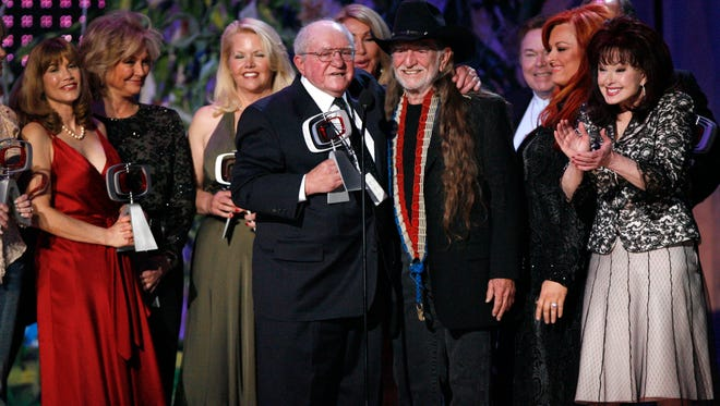 """In this April 14, 2007, file photo, producer Sam Lovullo, center left and singer Willie Nelson, right along with the cast of the television show """"Hee Haw"""" accept the Entertainer's Award during the 5th Annual TV Land Awards in Santa Monica, Calif."""