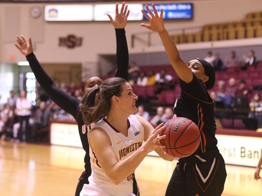 Midwestern State's Jennifer Arbuckle tries to get off a shot between two UT-Permian Basin defenders in their Jan. 7 meeting in Wichita Falls. UTPB won 82-78 ion overtime.