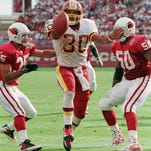 Washington Redskins' running back Brian Mitchell, center, scores his team's second touchdown between Arizona Cardinals' safety Aeneas Williams and linebacker Tony McComb. Mitchell will address students at Somerset Intermediate School in Westover on Aug. 28, according to the school system.