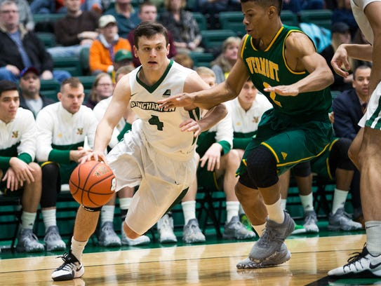 Binghamton University guard Timmy Rose drives to the