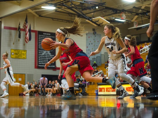 New Oxford's Kaelyn Long takes control of the ball off a rebound as  South Western's Madisyn McMaster follows up on defense on Friday night Dec. 18, 2015 in girls' basketball at South Western High School. New Oxford defeated South Western 42-30.