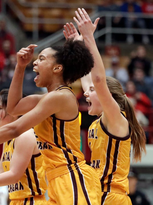 Central Michigan's Tinara Moore, left, and Kyra Bussell celebrate after Central Michigan defeated LSU 78-69 in a first-round game in the NCAA women's college basketball tournament, Saturday, March 17, 2018, in Columbus, Ohio. (AP Photo/Tony Dejak)