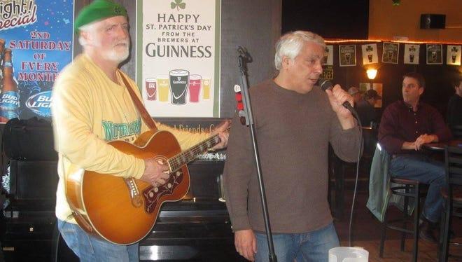 Richard V. Campagna takes the mic for karaoke.