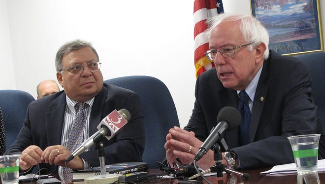 Sen. Bernie Sanders, I-Vt., speaks Monday about legislation he is introducing to advance employee-owned businesses. Joseph Blasi, right, an author and corporate governance professor specialist at Rutgers University, also spoke at the news conference in Burlington.