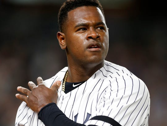 New York Yankees starting pitcher Luis Severino walks