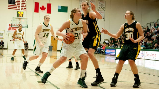 Catamounts forward Kayla Burchill (21) drives to the hoop in a game last season at Patrick Gym.