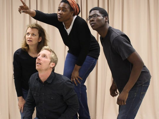 """The actors in The WordPlayers' production of """"Oh  Freedom! The Story of the Underground Railroad"""" act out a scene in which slaves find the  North Star in the sky as a way to find a way to escape slavery. From left, Jeni Lamm, Ethan Norman, Lena Allison and Malik Baines."""