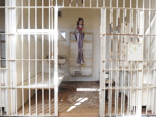A decorative vampire hangs inside an empty cell at Brushy Mountain State Penitentiary in Petros on Wednesday, Nov. 11, 2015.