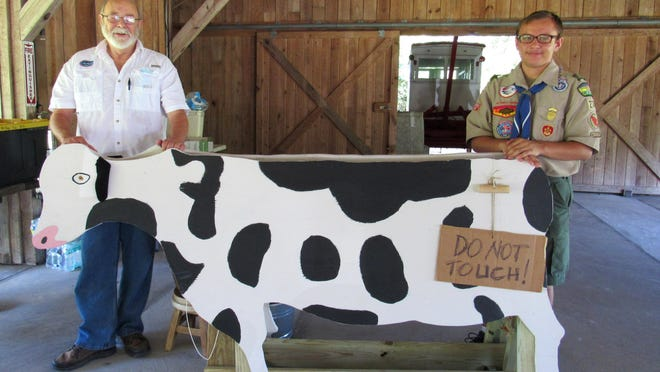 Florida Agricultural Museum historian James Fiske oversees the Eagle Scout projects, including the recent folding cow designed and built by Troop 274 Boy Scout James Albanese as his Eagle Scout project for the Florida Agricultural Museum.