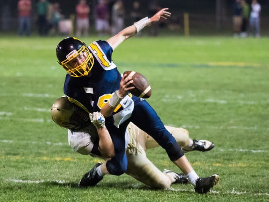 Littlestown's Jakob Lane (8) fumbles the ball while