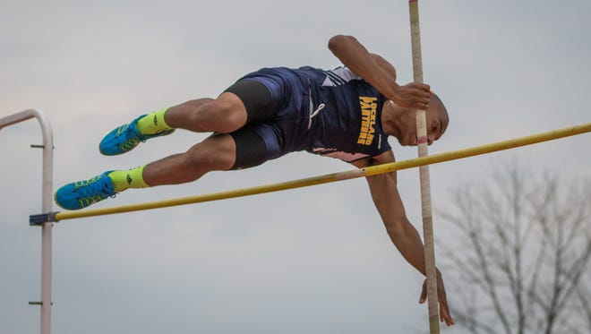 Lockland junior Eric Phillips clears 10 feet in the pole vault at the Division III district meet at New Richmond on Tuesday.
