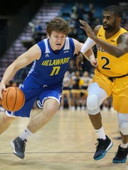Delaware's Ryan Daly drives against Drexel's Tramaine