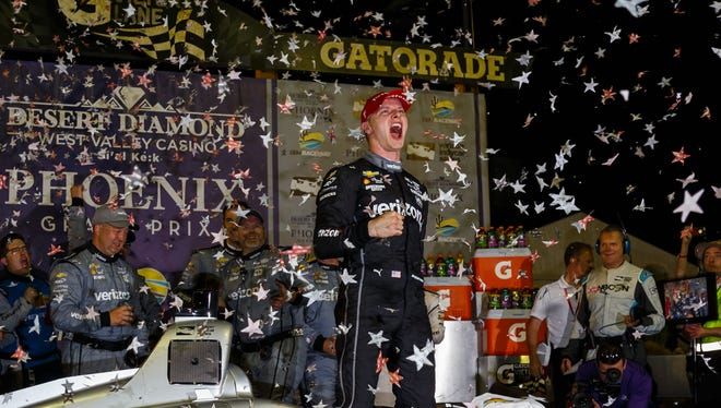 IndyCar driver Josef Newgarden celebrates after winning the Phoenix Grand Prix at ISM Raceway.