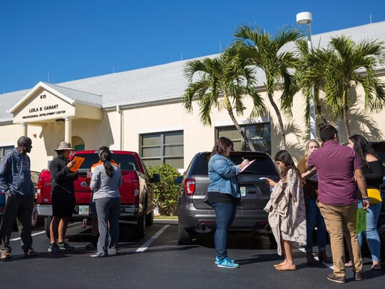 After their demonstration, protesters gather outside the Leila B Canant Professional Development Center in Naples to attend a meeting with Collier County Sheriff Kevin Rambosk and representatives from the U.S. Immigration and Customs Enforcement on Monday, Dec. 11, 2017.