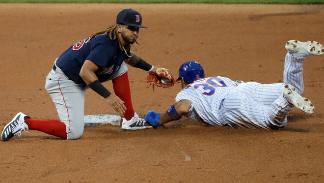 Boston Red Sox shortstop Jonathan Arauz, left, tags out New York Mets' Michael Conforto during the second inning of the baseball game at Citi Field, Thursday, July 30, 2020, in New York.