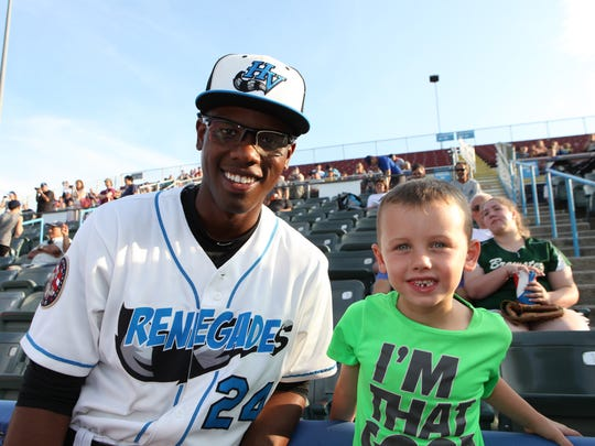 Renegades first baseman Nic Wilson poses for a photo with his host family's son, Roy Underwood Jr at Dutchess stadium in Fishkill on Thursday.